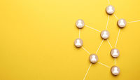 Abstract teamwork, network and community concept on a yellow paper background