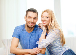 smiling happy couple at home