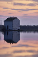 House reflected on lake water