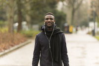 Young Black Man With Earphones Looking at Camera Confidently