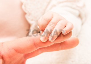 Hand of the newborn child
