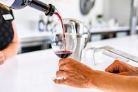 red wine tasting, bottle pouring