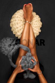 Young woman knit chunky merino pouf.