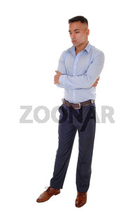Young man standing with his arms crossed