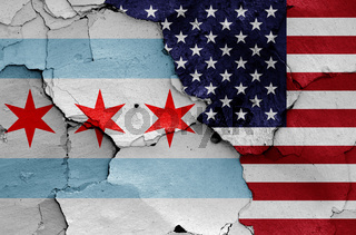 flags of Chicago and USA painted on cracked wall