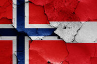 flags of Norway and Austria painted on cracked wall