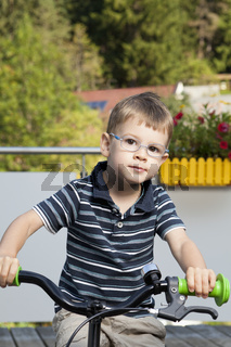 Proud child on bike