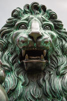 Close up of the head of a bronze sculpture of lion