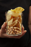 Chickpea chips and whole chickpea in glass pot.