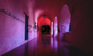 Corridor with arch reflections of the former monestary Convent de San Bernardino de Siena in Valladolid, Yucatan, Mexico