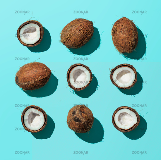 Coconuts on blue background, top view
