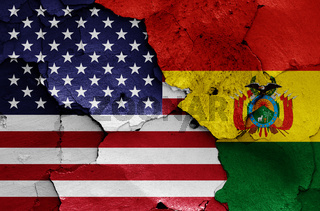 flags of USA and Bolivia painted on cracked wall