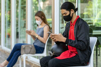Asian customers with face mask waiting for restaurant queue