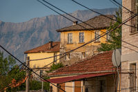 Medieval houses surrounded by mountains in Gjirokaster, Albania