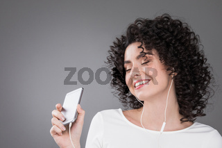 Woman dancing with earphones