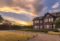 Sunset on Tokyo Metropolitan Park KyuFurukawa's old western-style mansion at red maple