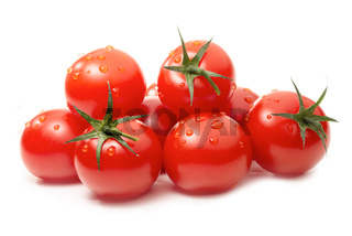 Fresh tomatoes with drops of water isolated