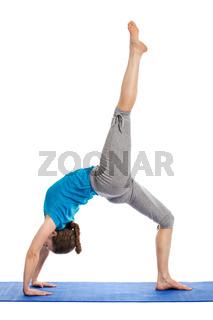 Yoga - young beautiful slender woman yoga instructor doing One-legged Upward Bow Pose (ekapada urdhva dhanurasana) asana exercise isolated on white background