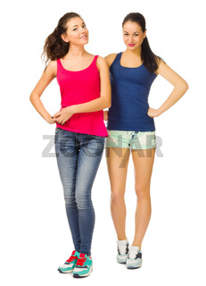 Two young smiling sporty girls isolated