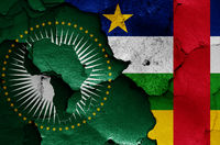 flags of African Union and Central African Republic painted on cracked wall