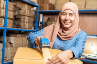 Islam Muslim warehouse worker packing goods cardboard box