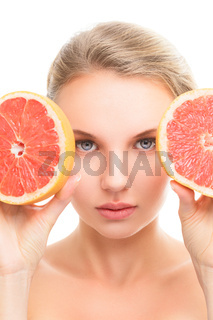 Young woman with orange in her hands