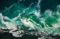 Waves of water of the river and the sea meet each other during high tide and low tide