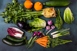 Assortment of healthy vegetables and ingredients for healthy and diet cooking on green background