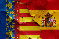 flags of Valencian Community and Spain painted on cracked wall