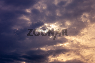 Natural sky composition. Dark ominous colorful storm rain clouds. Dramatic sky. Overcast stormy cloudscape. Thunderstorm. Element of apocalypse design. Toned.