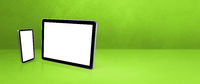 Mobile phone and digital tablet pc on green office desk. Background banner