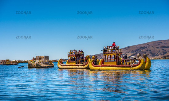 Puno, Peru - October, 9, 2015: Tourists on the reed boat, Uros floating islands of lake Titicaca, Peru, South America