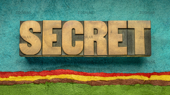 secret word abstract in wood type