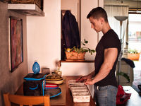 Muscular man preparing food containers for day