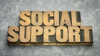 social support word abstract in wood type
