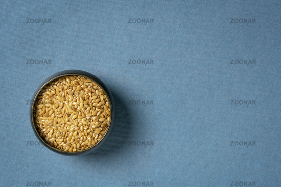 golden flax seeds in a small ceramic bowl