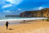Surfer surfboard woman Portugal beach