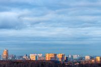 blue clouds over residential district in evening