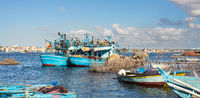 Fishing boats parked at River Nile at cloudy winter day