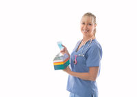 Smiling nurse holding a box of surgical medical masks or much needed PPE
