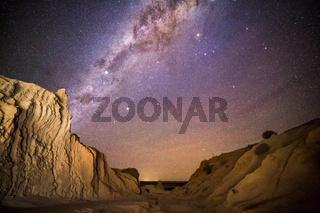 Night skies over desert landscape