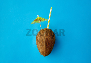 coconut drink with straw and cocktail umbrella