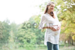 Expecting woman in nature