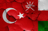 flags of Turkey and Oman painted on cracked wall