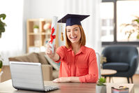 student woman with laptop and diploma at home