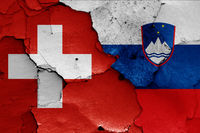 flags of Switzerland and Slovenia painted on cracked wall