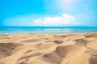 Blur defocused background of tropical beach and blue sea and sky with white cloud