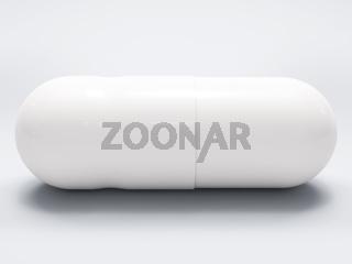 White medical pill on white background