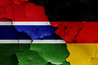 flags of Gambia and Germany painted on cracked wall