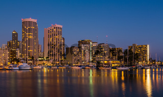 Yachts in Ala Moana harbor in Waikiki at night